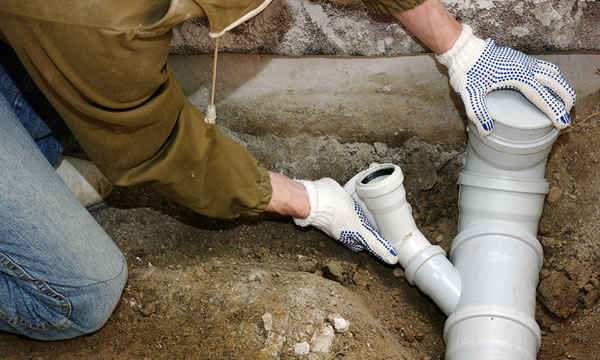 Mark is working on a drain cleaning repair which is part of our plumbing services
