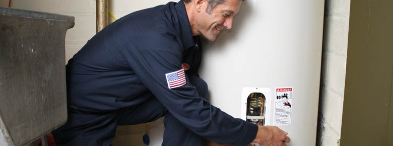 Jeff is making the final adjustments to a water heater