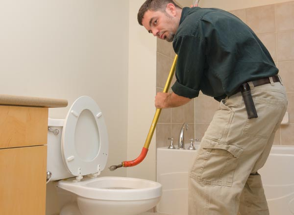 Jack performs a clogged toilet repair in Fremont by snaking the drain