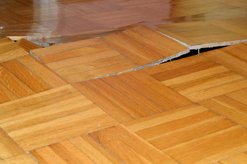 a slab leak insurance coverage issue: leaks pushing up through floorboards
