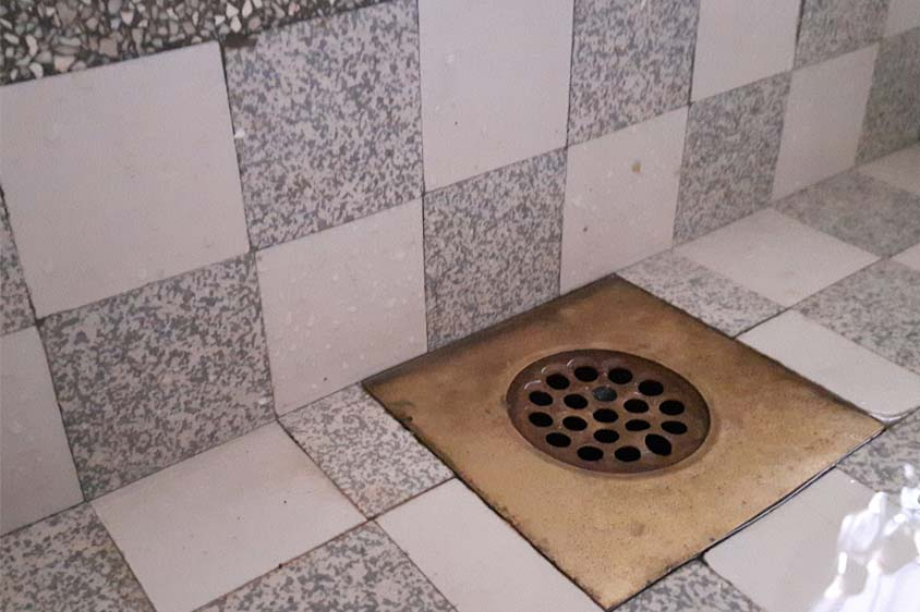 an unclogged shower drain
