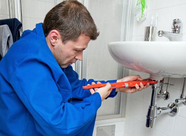 one of our plumbers in Hayward is working on a sink fix