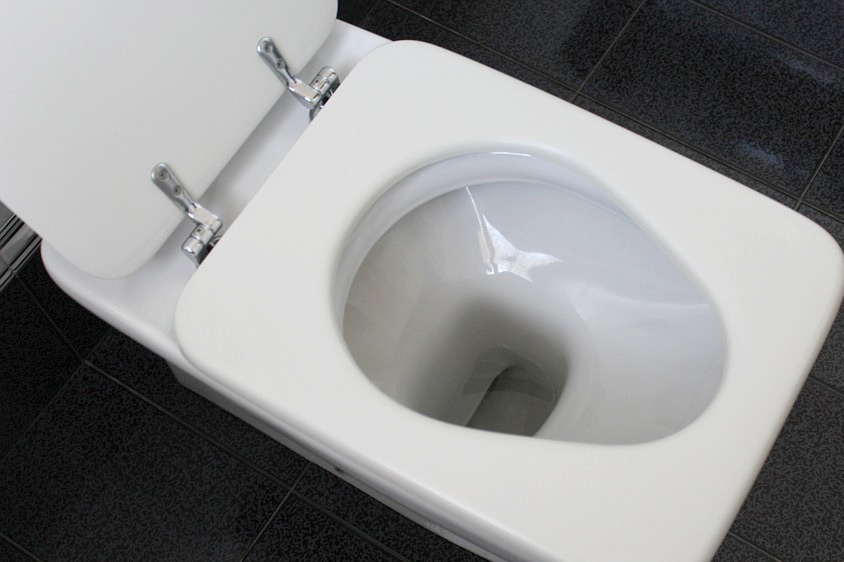 why does my toilet randomly run for a few seconds?